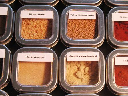 Group of spice tins organized alphabetically