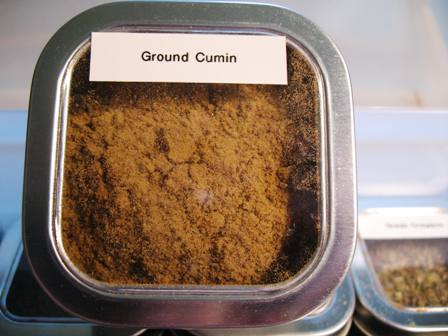 Ground cumin in a tin with a label